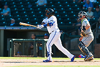 Surprise Saguaros designated hitter Vladimir Guerrero Jr. (27), of the Toronto Blue Jays organization, follows through on his swing in front of catcher Joe DeCarlo (4) during an Arizona Fall League game against the Peoria Javelinas at Surprise Stadium on October 17, 2018 in Surprise, Arizona. (Zachary Lucy/Four Seam Images)
