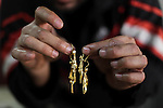 A Palestinian jeweller displays gold earrings at his workshop in Gaza city on February 18, 2013. Photo by Ashraf Amra