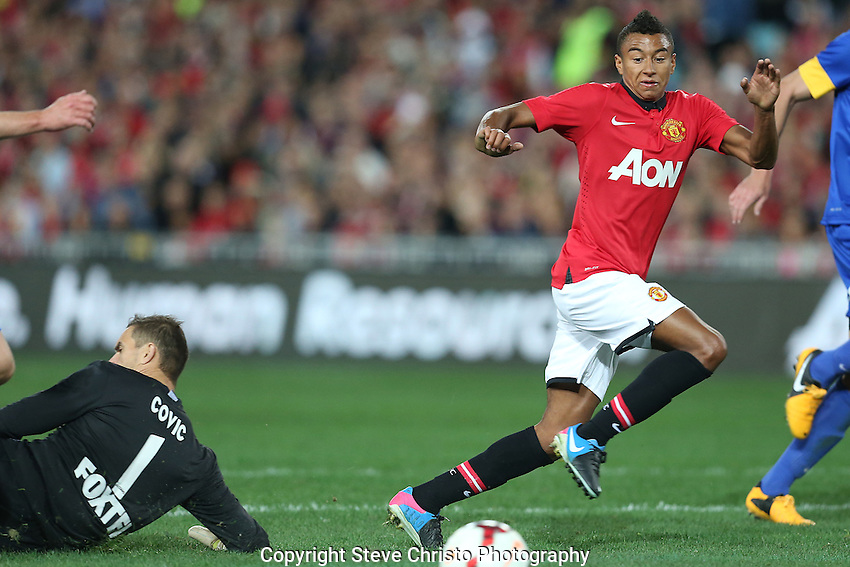 Manchester United's Jesse Lingard watches the ball go passed A-League All Stars goalkeeper Ante Covic at Stadium Australia, Sydney, Australia. Saturday, 20th July, 2013. (Photo: Steve Christo)