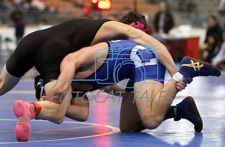 Carson's Jordan Luhrs defeats Jon Britt of Illinois Valley at the Sierra Nevada Classic wrestling tournament in Reno, Nev., on Friday, Dec. 28, 2012.  .Photo by Cathleen Allison