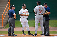 Bluefield Orioles manager Orlando Gomez (23) exchanges lineup cards with coach DJ Boston (54) of the Greeneville Astros at Bowen Field in Bluefield, WV, Sunday July 6, 2008. (Photo by Brian Westerholt / Four Seam Images)