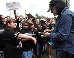 SIOUX FALLS, SD - JULY 20: KISS member Gene Simmons signs autographs for kids at the Brennan Rock & Roll Academy Saturday afternoon in Sioux Falls.  (Photo by Dave Eggen/Inertia)