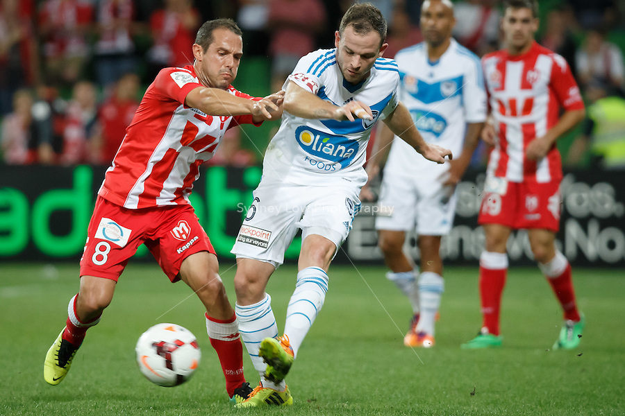 Massimo MURDOCCA of the Heart and Leigh BROXHAM of the Victory fight for the ball in the round 21 match between Melbourne Heart and Melbourne Victory in the Australian Hyundai A-League 2013-24 season at AAMI Park, Melbourne, Australia. Photo Sydney Low/Zumapress<br /> <br /> This image is not for sale on this web site. Please visit zumapress.com for licensing