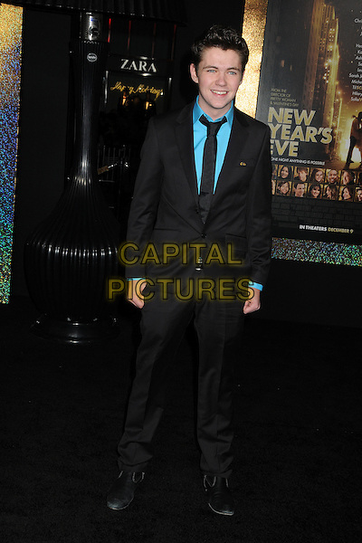 "Damian McGinty.The World Premiere of ""New Year's Eve' held at The Grauman's Chinese Theatre in Hollywood, California, USA..December 5th, 2011.full length suit black blue turquoise shirt tie .CAP/ADM/BP.©Byron Purvis/AdMedia/Capital Pictures."