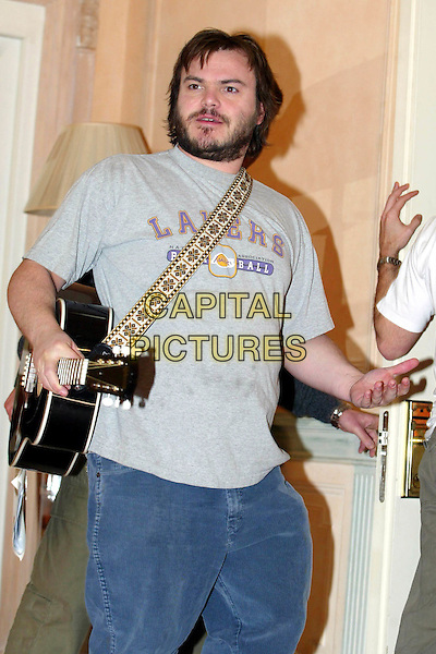 JACK BLACK.School Of Rock photocall in Rome.12 February 2004.half length, half-length, playing guitar.www.capitalpictures.com.sales@capitalpictures.com.© Capital Pictures.