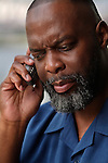 Serious African American man talking on cell phone