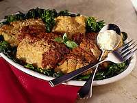Breaded Haddock with tomato sauce.