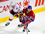 22 March 2010: Montreal Canadiens' left wing forward Mathieu Darche keeps the puck away from Ottawa Senators center Zack Smith at the Bell Centre in Montreal, Quebec, Canada. The Senators shut out the Canadiens 2-0 in their last meeting of the regular season. Mandatory Credit: Ed Wolfstein Photo