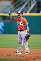 Durham Bulls first baseman J.P. Arencibia (16) waves to teammates in the dugout during a game against the Buffalo Bisons on June 13, 2016 at Coca-Cola Field in Buffalo, New York.  Durham defeated Buffalo 5-0.  (Mike Janes/Four Seam Images)