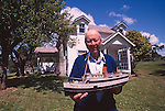 Puget Sound steamboats, Bill Somers, Founder, Puget Sound Museum with model of a turn of the century steamboat, Stretch Island, South Sound, Washington State, Pacific Northwest, USA.
