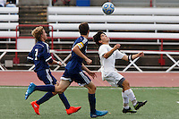 Mishawaka Marian's Christian Juarez, right, locates the ball in front of Providence defenders during the IHSAA Class A Boys Soccer State Championship Game on Saturday, Oct. 29, 2016, at Carroll Stadium in Indianapolis. Marian won 4-0. Special to the Tribune/JAMES BROSHER