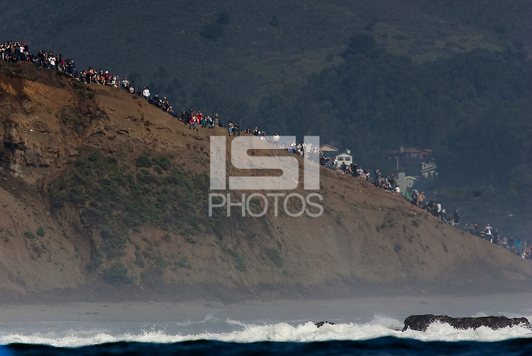 Spectators watch from the cliffside at the 2010 Mavericks Surf Contest in Half Moon Bay, California on February 13th, 2010.