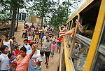 Village near Tegucigalpa, Honduras. Waving goodbye from mission school bus.