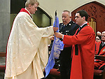 Mayor of Drogheda Kevin Callan brings the United Nations flag to the altar at the annual road death mass at Augustinian church Drogheda. Photo: Colin Bell/pressphotos.ie