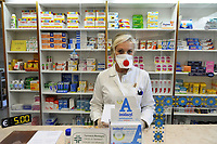 - epidemia di Coronavirus, vivere con la mascherina, la farmacia, Milano, Aprile 2020<br /> <br /> - Coronavirus epidemic, live with the mask, the pharmacy, Milan, April 2020