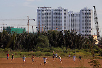 Vietnamese play soccer with the New Saigon building project in the background on Nguyen Huu Tho Street in District 7 in Ho Chi Minh City, Vietnam...Photo taken Wednesday, November 11, 2009. Kevin German / Luceo Images