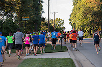 Fleet Feet St. Louis' Jeff Neuswander and a few other runners bring up the rear of the pack during the Run with Meb event in Des Peres, MO. Wednesday, September 3, 2014, hosted by Fleet Feet.