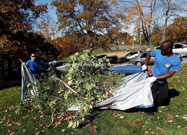 Waterbury, CT- 20 October 2013-102013CM05-  Ravy Chan, left, of Danbury and Dean Campbell, right, of Waterbury and members of the Waterbury Americorps, remove brush from outside the Fulton Park pool in Waterbury Sunday morning. Area residents, members of the Waterbury Police Explorers Post 414, the City Parks Department and the Americorps of Waterbury helped with the cleanup efforts.  Christopher Massa Republican-American
