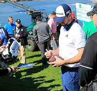 Green Bay Packers NFL quarterback Aaron Rodgers signs autographs at the 6th green at Pebble Beach Golf Links during Saturday's Round 3 of the 2017 AT&amp;T Pebble Beach Pro-Am held over 3 courses, Pebble Beach, Spyglass Hill and Monterey Penninsula Country Club, Monterey, California, USA. 11th February 2017.<br /> Picture: Eoin Clarke | Golffile<br /> <br /> <br /> All photos usage must carry mandatory copyright credit (&copy; Golffile | Eoin Clarke)