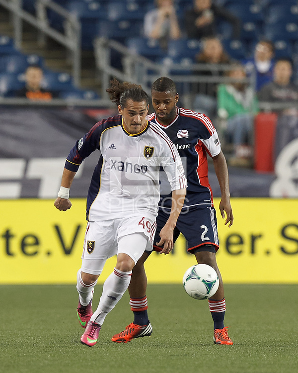 Real Salt Lake forward Devon Sandoval (49) controls the ball as New England Revolution defender Andrew Farrell (2) defends. In a Major League Soccer (MLS) match, Real Salt Lake (white)defeated the New England Revolution (blue), 2-1, at Gillette Stadium on May 8, 2013.