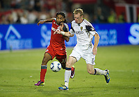 13 August 2011: Toronto FC forward Javier Martina #33 and Real Salt Lake defender Nat Borchers #6 in action during a game between Real Salt Lake and Toronto FC at BMO Field in Toronto..Toronto FC won 1-0.