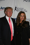 Donald & Melania Trump at Skating with the Stars (celebrities & Olympic skaters), a benefit gala for Figure Skating in Harlem on April 6, 2010 at Wollman Rink, Central Park, New York City, New York. (Photo by Sue Coflin/Max Photos)