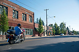 USA, Oregon, Willamette Valley, a motorcycle cruises through downtown Dayton