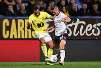 Bolton Wanderers' Pawel Olkowski competing with Blackburn Rovers' Elliott Bennett<br /> <br /> Photographer Andrew Kearns/CameraSport<br /> <br /> The EFL Sky Bet Championship - Bolton Wanderers v Blackburn Rovers - Saturday 6th October 2018 - University of Bolton Stadium - Bolton<br /> <br /> World Copyright &copy; 2018 CameraSport. All rights reserved. 43 Linden Ave. Countesthorpe. Leicester. England. LE8 5PG - Tel: +44 (0) 116 277 4147 - admin@camerasport.com - www.camerasport.com