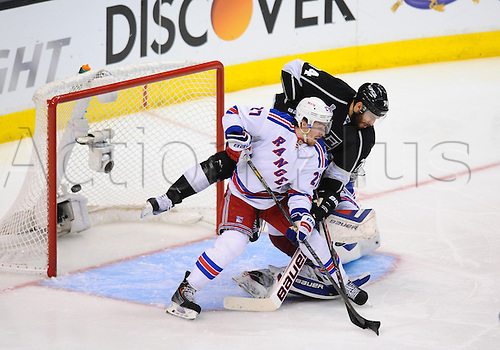 07 June 2014: Los Angeles Kings Left Wing Dwight King (74) [6247] is upended by New York Rangers Defenseman Ryan McDonagh (27) [6209] as the puck sails past New York Rangers Goalie Henrik Lundqvist (30) [2585] for the Kings third goal of the game in the third period during game 2 of the Stanley Cup Final between the New York Rangers and the Los Angeles Kings at Staples Center in Los Angeles, CA.