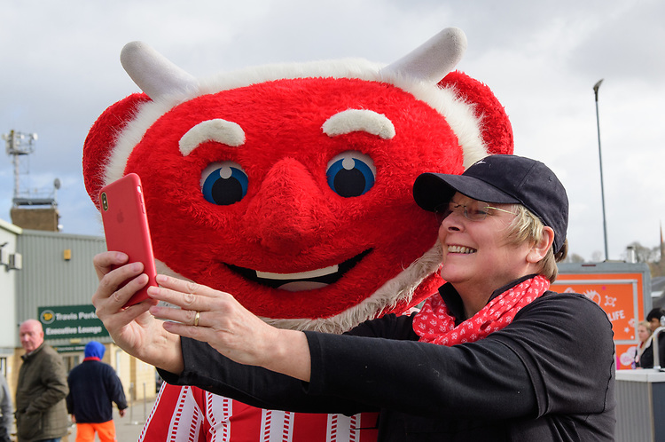 Lincoln City mascot Poacher the Imp has a selfie taken outside the ground with a fan<br /> <br /> Photographer Chris Vaughan/CameraSport<br /> <br /> The EFL Sky Bet League Two - Lincoln City v Northampton Town - Saturday 9th February 2019 - Sincil Bank - Lincoln<br /> <br /> World Copyright © 2019 CameraSport. All rights reserved. 43 Linden Ave. Countesthorpe. Leicester. England. LE8 5PG - Tel: +44 (0) 116 277 4147 - admin@camerasport.com - www.camerasport.com