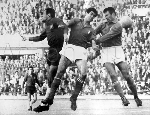 Chilean forward Fouilloux (L) leaps into the air and struggles with Italian defenders Robotti (C) and Tumburus (R) for the ball during the 1962 World Cup match Chile versus Italy at the National Stadium in Santiago de Chile, Chile, 2 June 1962. Chile won the game 2-0 in front of 66,000 spectators. The game was considered to be a scandal due to a continuous series of fouls and assaults on the pitch which disrupted the game. Two Italian players were sent off and one player only left when police officers escorted him off the pitch.