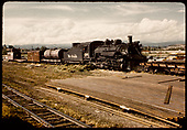 D&amp;RGW #481 K-36 with tank car, box car, flat car and caboose. Pipe stacked alongside track.<br /> D&amp;RGW  Farmington area ?, NM