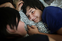 Ilmira Shayhraznova, 21, (R) shares an intimate moment with her girlfriend Elena Yakovleva, 23. On 30 June 2013, Russian President Vladimir Putin signed into law an ambiguous bill banning the 'propaganda of nontraditional sexual relations to minors'. The law met with widespread condemnation from human rights and LGBT groups. (MANDATORY CREDIT   photo: Mads Nissen/Panos Pictures /Felix Features)