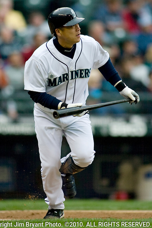 Seattle Mariners' Kenji Johjima, of Japan watches his pop fly to center field in the sixth inning against the Los Angeles Angels at Safeco Field in Seattle. Jim Bryant Photo. ©2010. ALL RIGHTS RESERVED.