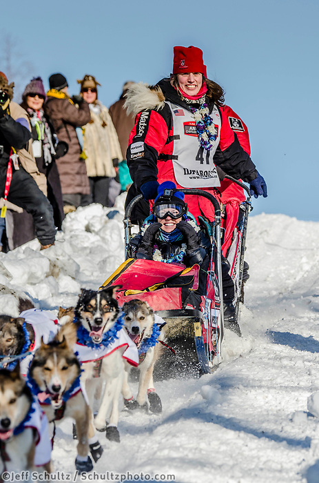 Aliy Zirkle and team run past spectators and down the Cordova Street hill with an Iditarider in the basket and a handler during the Anchorage, Alaska ceremonial start on Saturday March 4th during the 2017 Iditarod race. Photo ©2017 by Kristie Lent/SchultzPhoto.com