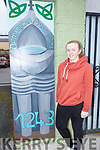 Student Caitlin O'Sullivan from the Kerry College of Education standing by the mural that she painted in the Abbey carpark on Tuesday.