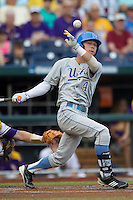 UCLA Bruin outfielder Eric Filia (4) fouls a ball during Game 4 of the 2013 Men's College World Series against the LSU Tigers on June 16, 2013 at TD Ameritrade Park in Omaha, Nebraska. UCLA defeated LSU 2-1. (Andrew Woolley/Four Seam Images)