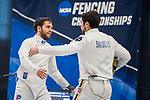 UNIVERSITY PARK, PA - MARCH 25: Ariel Simmons of Notre Dame University congratulates Marc Blais-Antoine of Ohio State University on his victory in the epee competition during the Division I Men's Fencing Championship held at the Multi-Sport Facility on the Penn State University campus on March 25, 2018 in University Park, Pennsylvania. (Photo by Doug Stroud/NCAA Photos via Getty Images)