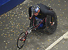 Peter Hawkins of Malverne, NY rolls past the finish line in Central Park to complete the TCS New York City Marathon as a wheelchair competitor on Sunday, Nov. 5, 2017.