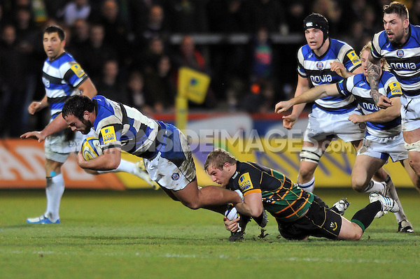 Charlie Beech is tackled to ground. Aviva A-League final, between Northampton Wanderers and Bath United on December 16, 2013 at Franklin's Gardens in Northampton, England. Photo by: Patrick Khachfe / Onside Images