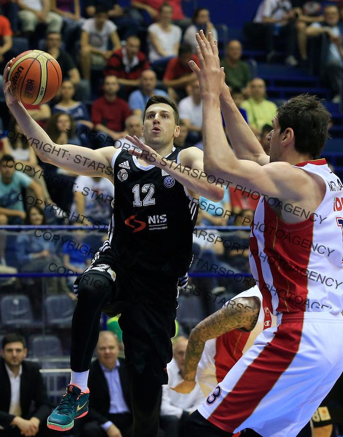 Kosarka Kosarkaska Liga Srbije season 2014-2015<br /> Crvena Zvezda v Partizan<br /> Dragan Milosavljevic (L) and Boban Marjanovic<br /> Belgrade, 05.17.2015.<br /> foto: Srdjan Stevanovic/Starsportphoto &copy;