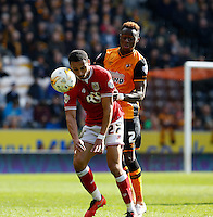 Hull City v Bristol City 2.4.16 .Sky Bet Championship ....... Bristols Peter Odemwingie with hulls moses Odubajo