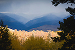 Sunlight through clouds in western Montana near Missoula in fall colors