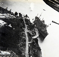 BNPS.co.uk (01202 558833)<br /> Pic:  Tooveys/BNPS<br /> <br /> Taken on 28/08/41 - A daylight attack on shipping at Rotterdam, showing the sister ship to the 'Noordam' which was seized by the Germans.   The Blenheim pictured just above the mast scored a direct hit on the vessel, capsizing the boat.<br /> <br /> Dramatic photos showing a series of heart-pounding World War Two bombing raids from the pilot's perspective have come to light.<br /> <br /> They were taken from Blenheim bombers undertaking attacks on targets in Germany and Nazi-occupied Netherlands in 1941.<br /> <br /> Several capture the immediate aftermath of a direct hit, with flames and clouds of smoke signifying they had achieved their aim.<br /> <br /> The album, which contains almost 100 photos, has emerged for sale with Toovey's Auctions, of Washington, west Sussex.