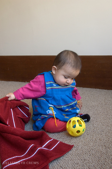 Berkeley CA Eight-month-old Guatemalan girl finding ball hidden underneath towel (mastery of object permanence test) MR