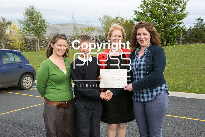 Pictured at the presentation of certificated by EcoEco Beo to students from New Quay National school were: Bridget Barry,Burren Beo Trust, Student Oisin Keane,Carmel Thynne, Principal New Quay NS, Aine Bird, Eco Beo Co ordinator . Pictured Credit Brian Gavin Press 22