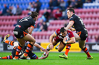 Picture by Alex Whitehead/SWpix.com - 20/04/2018 - Rugby League - Betfred Super League - Wigan Warriors v Castleford Tigers - DW Stadium, Wigan, England - Wigan's Ben Flower is tackled by Castleford's Oliver Holmes and Joe Wardle.