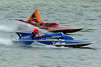 "Tom & Jac Bertolini, N-8 ""Country Boy"", 1971 Lauterbach 225 class hydroplane & Steve Lindo, E-103 ""Vagabond"", 1964 Sooy 280 class hydroplane..2004 Madison Regatta, Madison, Indiana, July 4, 2004..F. Peirce Williams .photography.P.O.Box 455 Eaton, OH 45320.p: 317.358.7326  e: fpwp@mac.com."