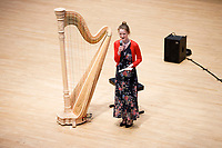 Mathilde Wauters from Belgium speaks before performing during Stage III at the 11th USA International Harp Competition at Indiana University in Bloomington, Indiana on Wednesday, July 10, 2019. (Photo by James Brosher)