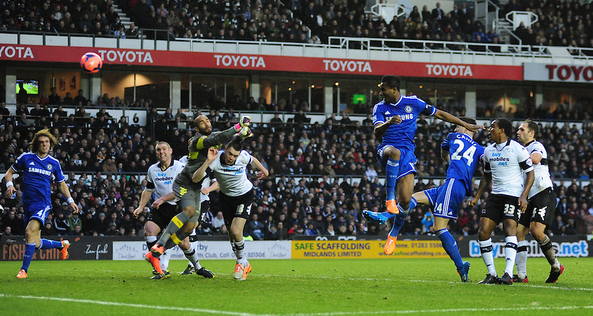 Chelsea's Mikel John Obi scores the opening goal <br /> <br /> Photo by Chris Vaughan/CameraSport<br /> <br /> Football - FA Challenge Cup Third Round - Derby County v Chelsea - Sunday 5th January 2014 - The iPro Stadium - Pride Park - Derby <br /> <br />  &copy; CameraSport - 43 Linden Ave. Countesthorpe. Leicester. England. LE8 5PG - Tel: +44 (0) 116 277 4147 - admin@camerasport.com - www.camerasport.com